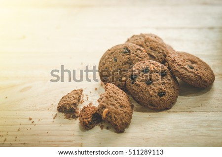 Cookie chocolate chip on wood table(Vintage tone)