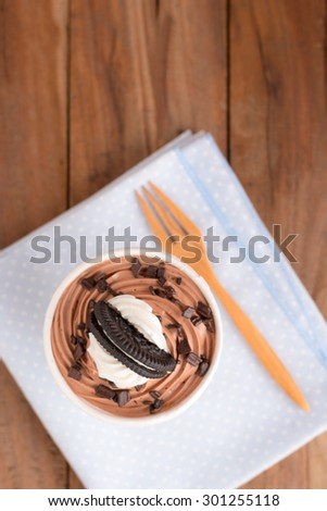 cookie cup cake on wooden table - stock photo