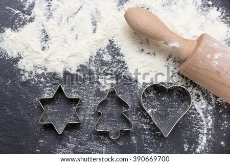 cookie cutter on slate with flour - stock photo
