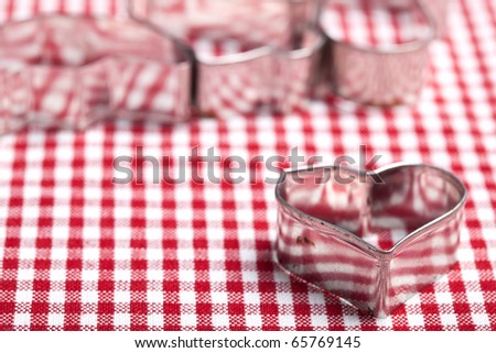 Cookie Cutters for christmas bakery on chequered cloth