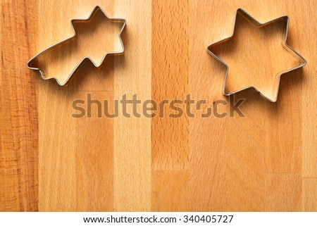 Cookie cutters on wooden table
