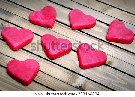 Cookie heart on wooden table - stock photo