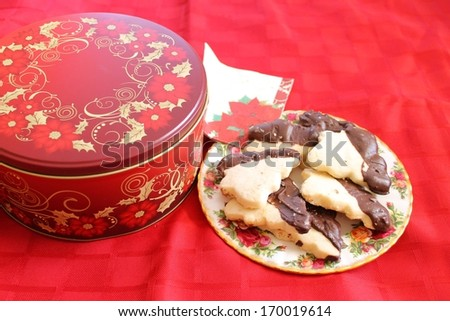 Cookie tin and plateful - stock photo