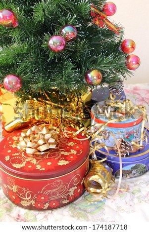 Cookie tins under the tree - stock photo