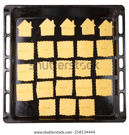 Cookie with signs on baking tray isolated on white background - stock photo