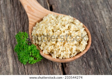 cookied quinoa on wooden surface - stock photo