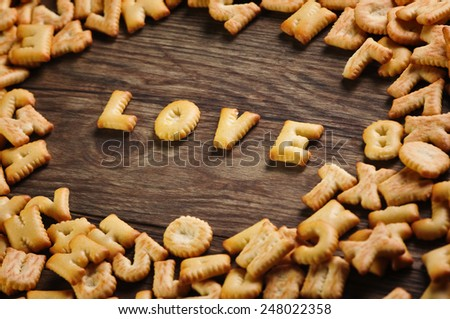 Cookies ABC in the form of word LOVE alphabet on old wood background, Valentines day - stock photo