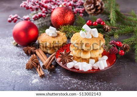 cookies about marshmallows and Christmas balls on a table, selective focus, copy space