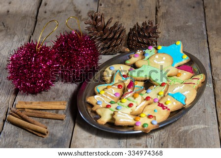 Cookies and Christmas decorations on wooden table - stock photo