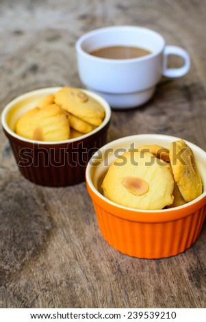 Cookies and cup of coffee on wooden table