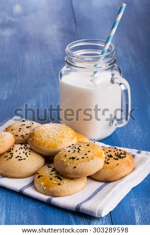 Cookies and glass of milk on blue background.  - stock photo