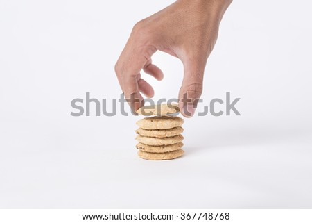 cookies and hand take a cookie isolated on white background