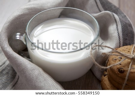 Cookies and warm milk in the mug