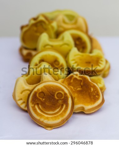 Cookies are many delicious pastries sphere which placed the overlap on the floor. - stock photo