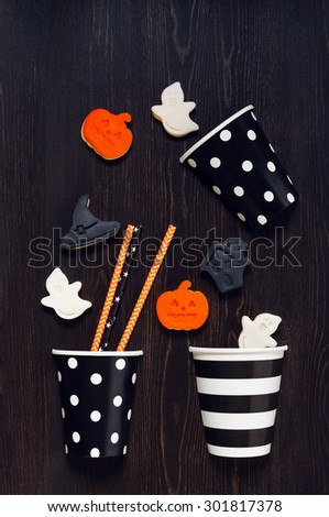 Cookies for Halloween party on the wooden black table - stock photo