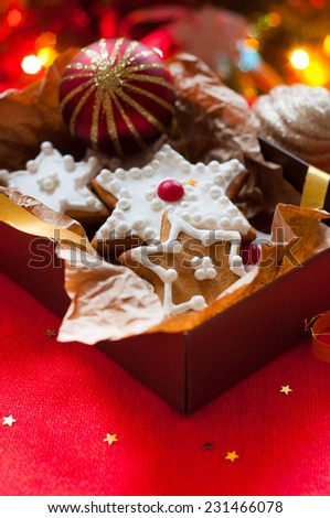 cookies in a gift box on the background of the Christmas tree