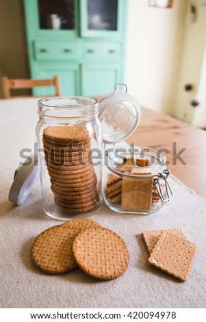 Cookies in glass jar on wooden table