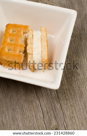 Cookies in the dish with backing of natural wood  - stock photo