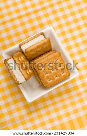 Cookies in the pot on the colored unique backing - stock photo