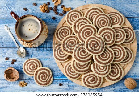 Cookies in the shape of a spiral on a wooden tray. Handmade biscuits - stock photo