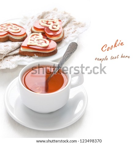 Cookies in the shape of heart with cherry jelly and white chocolate and morning tea - stock photo