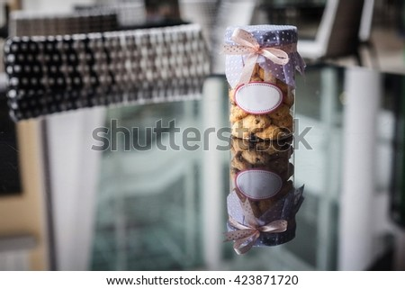 Cookies inside jar with white blank label - stock photo