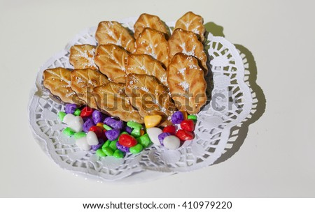 Cookies lies on a white plate,candy lie on plate,colorful candy lie on a white plate, delicious candy lie on plate isolated on white, - stock photo