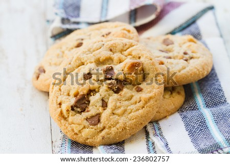 Cookies mix chocolate and macadamia on  the wooden floor