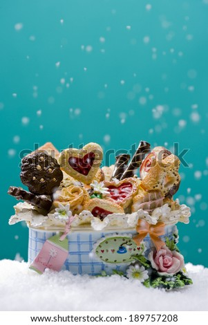 Cookies on basket with snow - stock photo