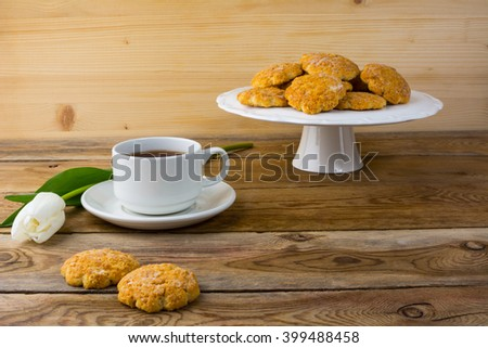 Cookies on the cake stand. Tea cookies. Biscuits. Breakfast cookie. Dessert cookies. . Sweet cookie. Homemade cookies. Sweet pastry. Cookie. Tea. Tea cup - stock photo