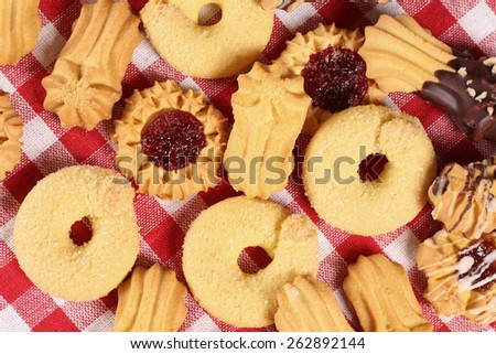 Cookies on the table, top view. Confectionery. Delicious cookies from the dough on a red and white tablecloth. Background, texture of the cookie. A restaurant, a coffee shop, a pastry shop.  - stock photo