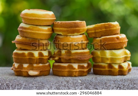 Cookies, soft spherical array superimposed vertical rows with green blur the background. - stock photo