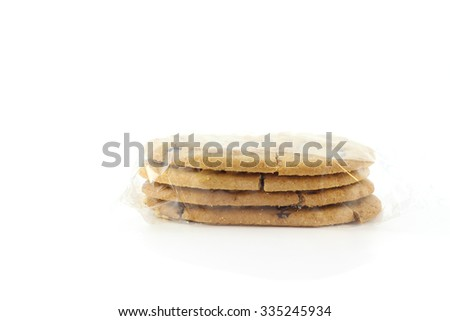 Cookies stacked in plastic pack on the white background - stock photo