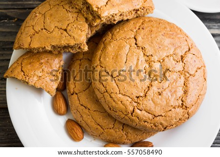 Cookies with almonds on a white plate. Tasty dessert.