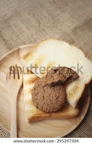 Cookies with breads on background of brown.
