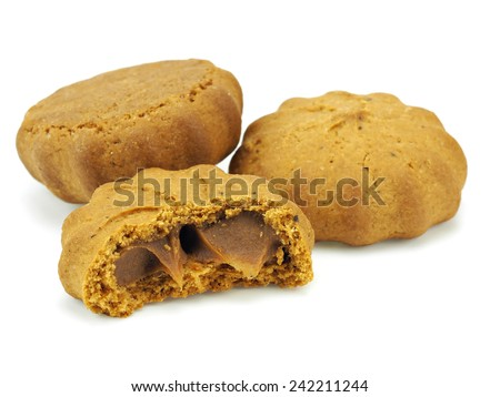 Cookies with caramelized condensed milk on a white background - stock photo