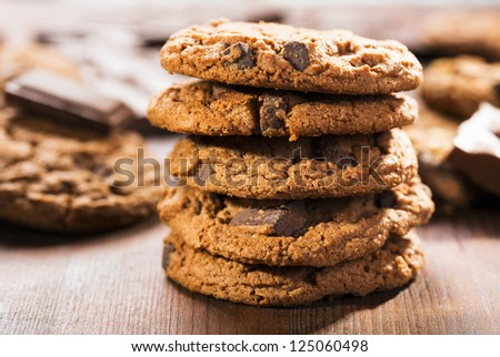 cookies with chocolate on wooden table - stock photo