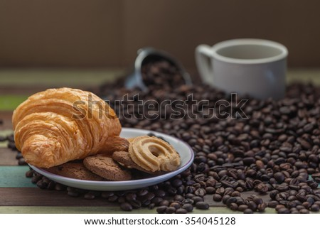Cookies with coffee cup and beans - stock photo
