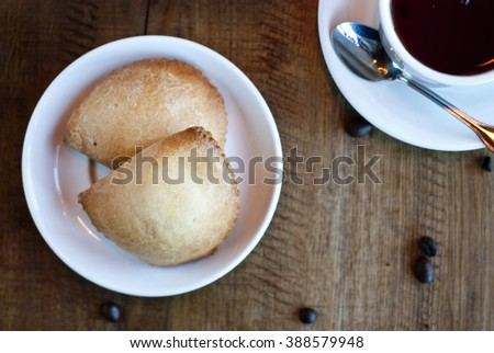Cookies with cup of tea - stock photo