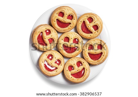 Cookies with jam in plate on a white background, top view