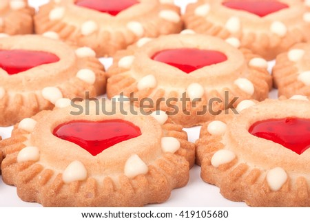 cookies with jelly and hearts as a background - stock photo
