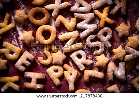 Cookies with letters shapes and sugar powder - stock photo