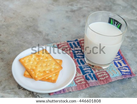 Cookies with milkon the concrete table in the office - stock photo