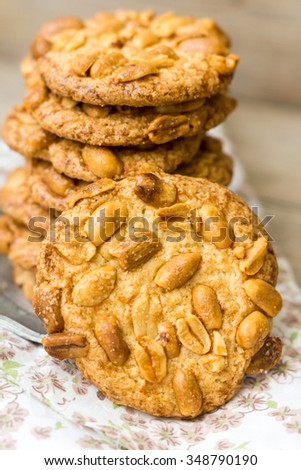 cookies with peanuts on a wooden background