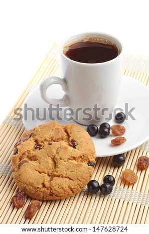Cookies with raisins and blueberries and cup of coffee