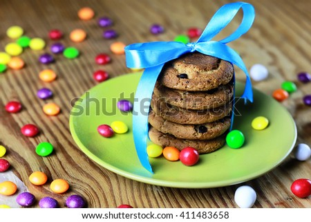cookies with ribbon on plate candy - stock photo