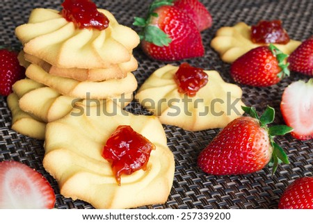 Cookies with strawberry jam decorated fresh berries. Selective focus