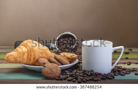 Cookies with white cup and beans background - stock photo