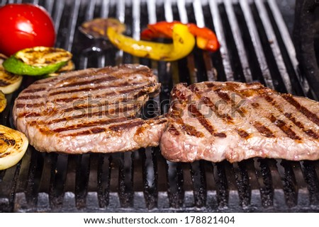 cooking a steak on the grill