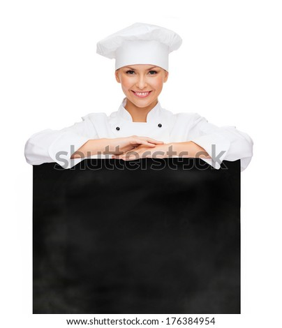cooking, advertisement and food concept - smiling female chef, cook or baker with white blank board - stock photo